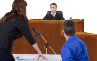 A Criminal Defense Attorney Speaking To A Judge In A Courtroom