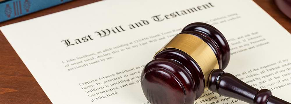 A Gavel Resting On Top Of A Last Will & Testament