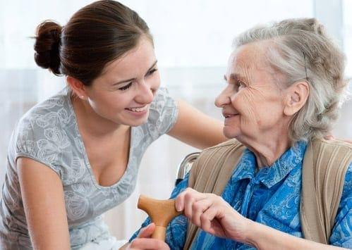 A Woman Caring For A Senior Citizen