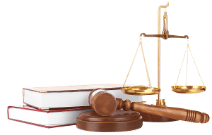 A Scale, Gavel And Books Sitting On A Table In A Law Firm